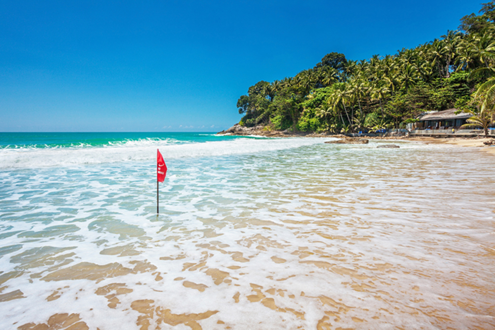 Red warning flag at beach. Phuket, Thailand.