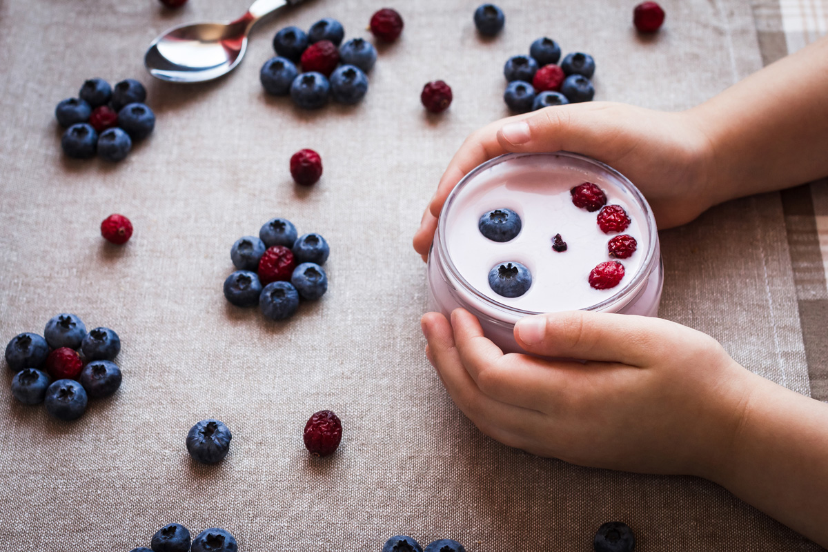 Yogurt and Berries with a Smile for a Picky Eater