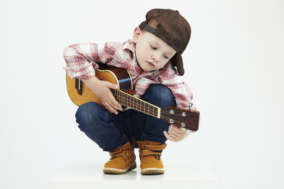 Boy with guitar might be a picky eater!