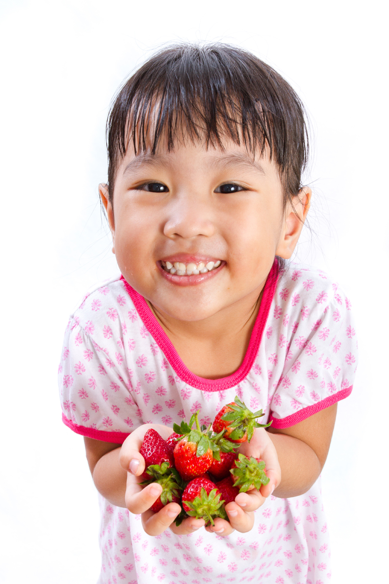 Cute girl with strawberries